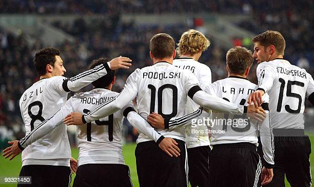 Lukas Podolski of Germany and his team mates Mesut Oezil Piotr Trochowski Stefan Kiessling Philipp Lahm and Thomas Hitzlsperger celebrate the first...