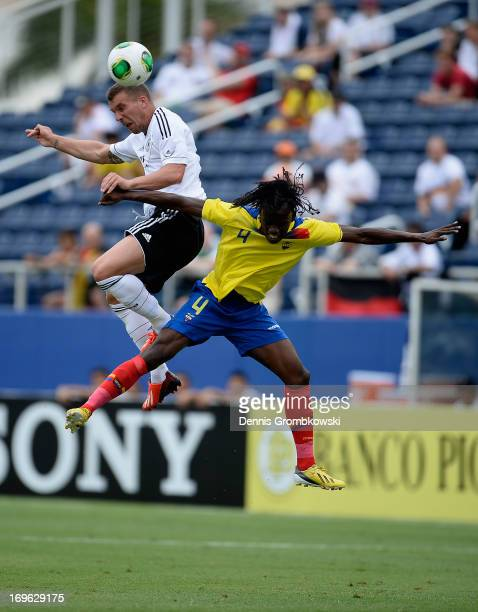 Lukas Podolski of Germany and Juan Carlos Paredes go up for a header during the International Friendly match between Ecuador and Germany at FAU...