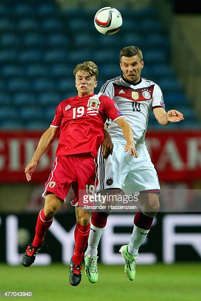Lukas Podolski of Germany battles for the ball with James Coombes of Gibraltar during the UEFA EURO 2016 Qualifier Group D match between Gibraltar...