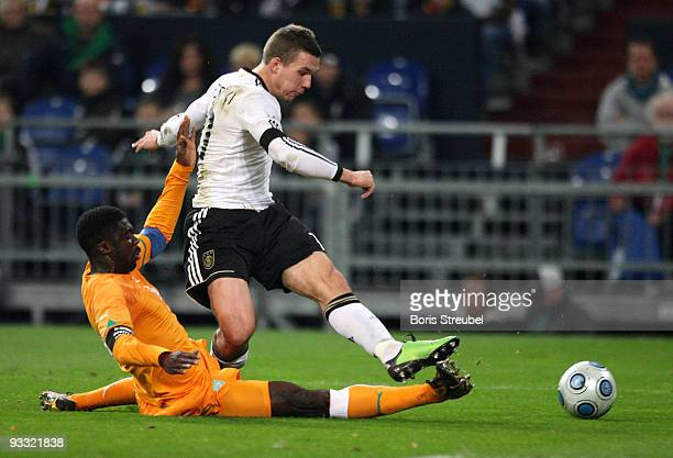 Lukas Podolski of Germany battles for the ball with Kolo Toure of Ivory Coast during the International Friendly match between Germany and Ivory Coast...