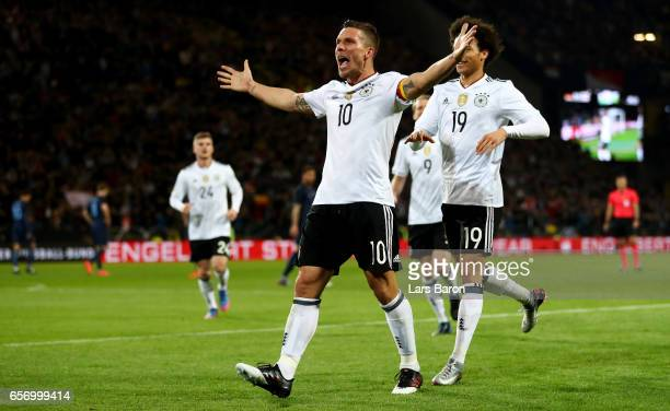 Lukas Podolski of Germany celebrates after scoring his teams first goal during the international friendly match between Germany and England at Signal...
