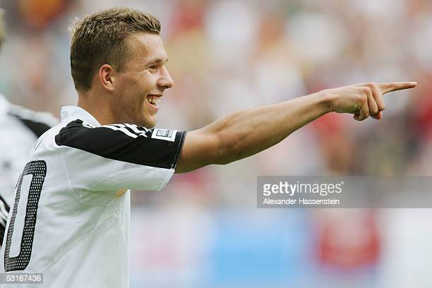 Lukas Podolski of Germany celebrates after the 3rd goal during the match between Germany and Mexico for third place in the FIFA Confederations Cup...