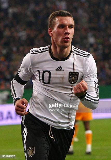 Lukas Podolski of Germany celebrates his second goal during the international friendly match between Germany and Ivory Coast at the Schalke Arena on...