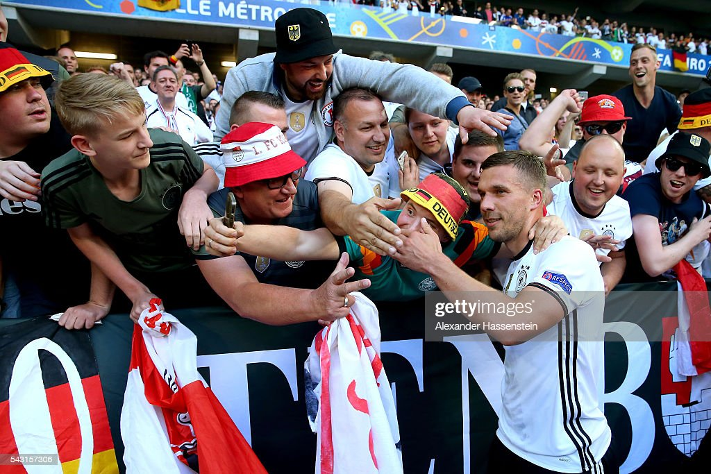<a gi-track='captionPersonalityLinkClicked' href=/galleries/search?phrase=Lukas+Podolski&family=editorial&specificpeople=204460 ng-click='$event.stopPropagation()'>Lukas Podolski</a> of Germany celebrates his team's 3-0 win with the supporters after the UEFA EURO 2016 round of 16 match between Germany and Slovakia at Stade Pierre-Mauroy on June 26, 2016 in Lille, France.