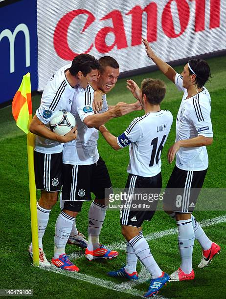 L'VIV UKRAINE JUNE 17 Lukas Podolski of Germany celebrates scoring their first goal with team mates during the UEFA EURO 2012 group B match between...