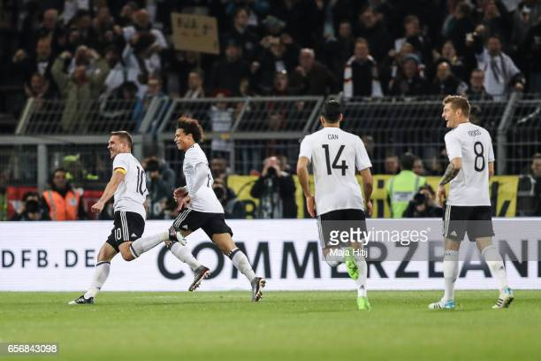 Lukas Podolski of Germany celebrates with Leroy Sane and his team mates after scoring a goal to make it 10 during the international friendly match...