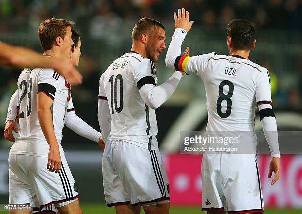 Lukas Podolski of Germany celebrates with Mesut Oezil as he scores their second goal during the international friendly match between Germany and...