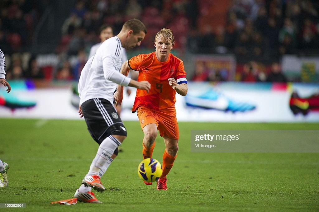 Lukas Podolski of Germany, Dirk Kuyt of Holland during the Friendly match between Holland and Germany at the Amsterdam Arena on November 14, 2012 in Amsterdam, The Netherlands.