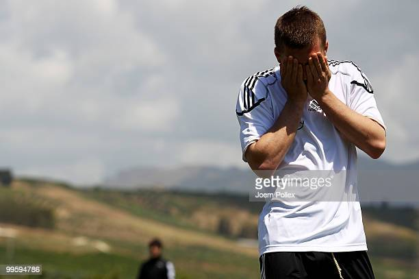 Lukas Podolski of Germany gestures during the German National Team training session at Verdura Golf and Spa Resort on May 16 2010 in Sciacca Italy