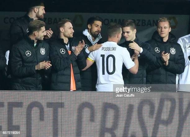 Lukas Podolski of Germany greets teammates Kevin Trapp Shkodran Mustafi Sami Khedira Julian Weigl after his replacement during the international...