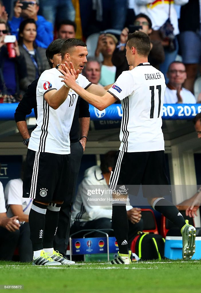 <a gi-track='captionPersonalityLinkClicked' href=/galleries/search?phrase=Lukas+Podolski&family=editorial&specificpeople=204460 ng-click='$event.stopPropagation()'>Lukas Podolski</a> (L) of Germany high fives <a gi-track='captionPersonalityLinkClicked' href=/galleries/search?phrase=Julian+Draxler&family=editorial&specificpeople=7184479 ng-click='$event.stopPropagation()'>Julian Draxler</a> (R) during the UEFA EURO 2016 round of 16 match between Germany and Slovakia at Stade Pierre-Mauroy on June 26, 2016 in Lille, France.