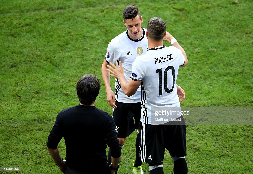 <a gi-track='captionPersonalityLinkClicked' href=/galleries/search?phrase=Lukas+Podolski&family=editorial&specificpeople=204460 ng-click='$event.stopPropagation()'>Lukas Podolski</a> (R) of Germany hugs <a gi-track='captionPersonalityLinkClicked' href=/galleries/search?phrase=Julian+Draxler&family=editorial&specificpeople=7184479 ng-click='$event.stopPropagation()'>Julian Draxler</a> (C) while head coach Joachim Loew watches during the UEFA EURO 2016 round of 16 match between Germany and Slovakia at Stade Pierre-Mauroy on June 26, 2016 in Lille, France.