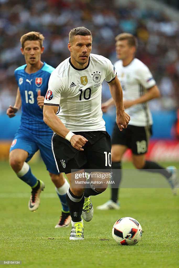 <a gi-track='captionPersonalityLinkClicked' href=/galleries/search?phrase=Lukas+Podolski&family=editorial&specificpeople=204460 ng-click='$event.stopPropagation()'>Lukas Podolski</a> of Germany in action during the UEFA Euro 2016 Round of 16 match between Germany and Slovakia at Stade Pierre-Mauroy on June 26, 2016 in Lille, France.