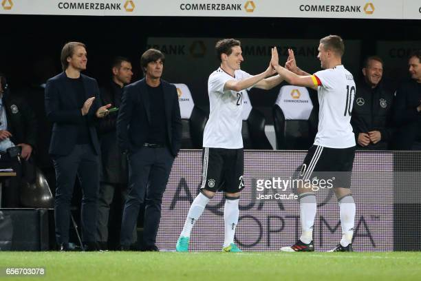 Lukas Podolski of Germany is replaced by Sebastian Rudy of Germany while assistant coach of Germany Thomas Schneider and coach of Germany Joachim...