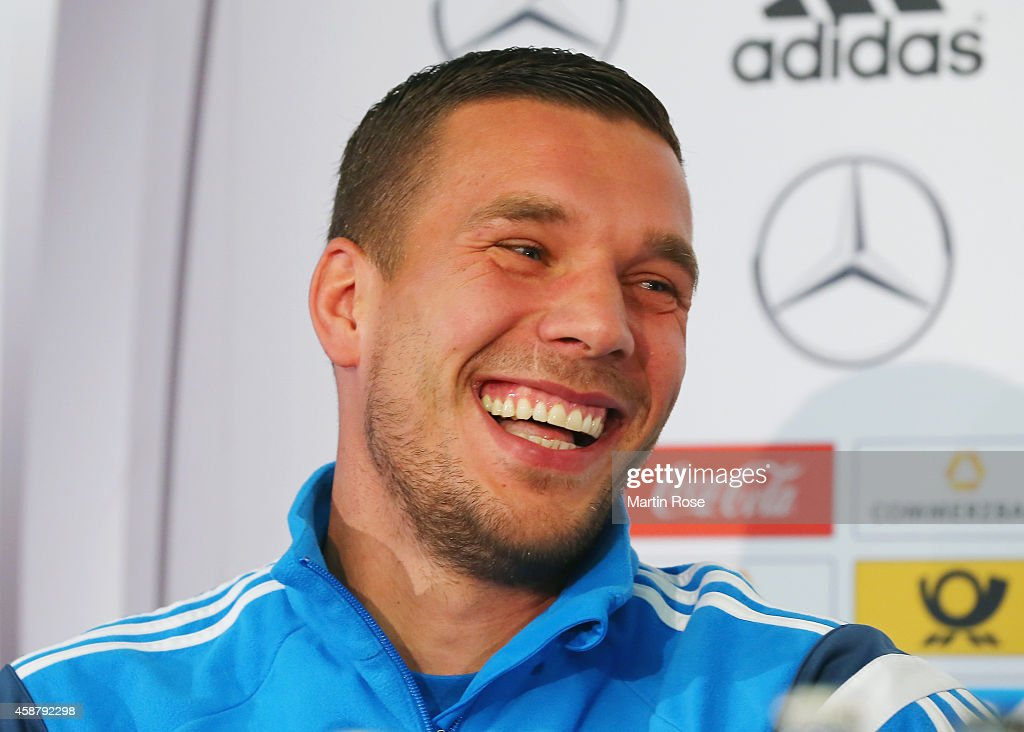 <a gi-track='captionPersonalityLinkClicked' href=/galleries/search?phrase=Lukas+Podolski&family=editorial&specificpeople=204460 ng-click='$event.stopPropagation()'>Lukas Podolski</a> of Germany laughs during a press conference ahead of their EURO 2016 Group D qualifying match against Gibraltar on November 11, 2014 in Berlin, Germany.
