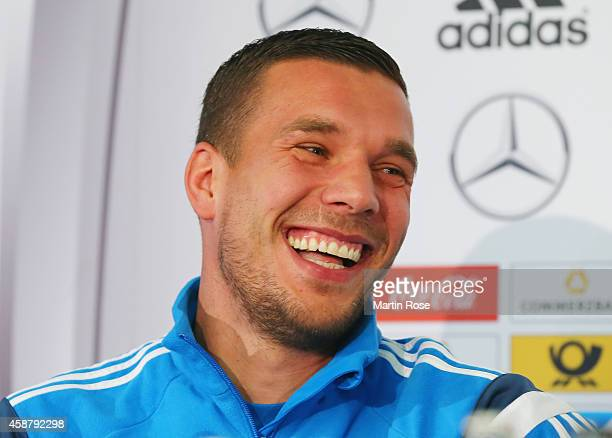 Lukas Podolski of Germany laughs during a press conference ahead of their EURO 2016 Group D qualifying match against Gibraltar on November 11 2014 in...
