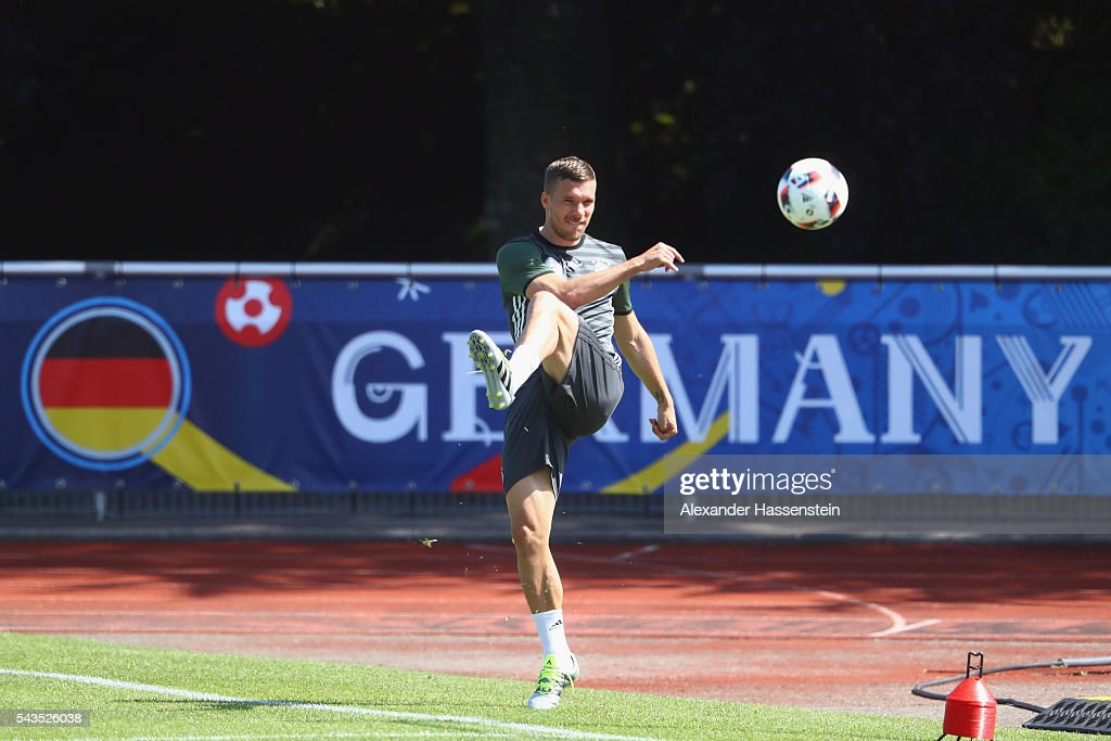 <a gi-track='captionPersonalityLinkClicked' href=/galleries/search?phrase=Lukas+Podolski&family=editorial&specificpeople=204460 ng-click='$event.stopPropagation()'>Lukas Podolski</a> of Germany plays the ball during a Germany training session at Ermitage Evian on June 29, 2016 in Evian-les-Bains, France.