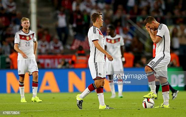 Lukas Podolski of Germany reacts during the International Friendly match between Germany and USA at RheinEnergieStadion on June 10 2015 in Cologne...