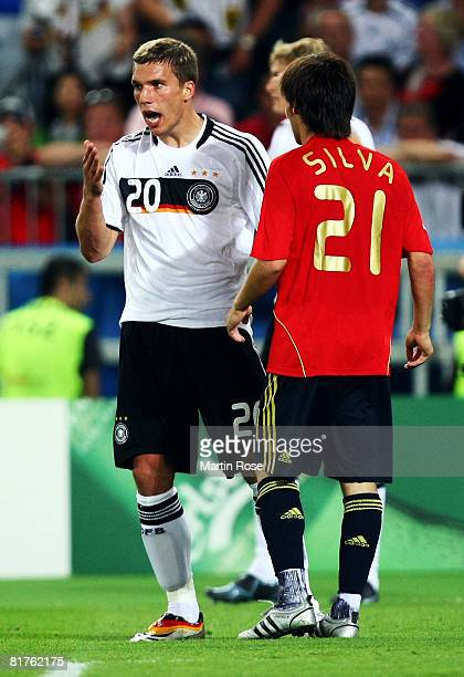 Lukas Podolski of Germany reacts with David Silva of Spain during the UEFA EURO 2008 Final match between Germany and Spain at Ernst Happel Stadion on...