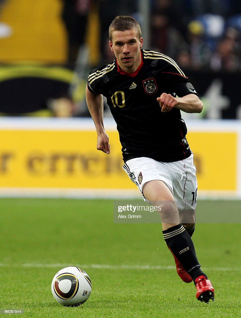 Lukas Podolski of Germany runs with the ball during the international friendly match between Germany and Malta at Tivoli stadium on May 13, 2010 in Aachen, Germany.