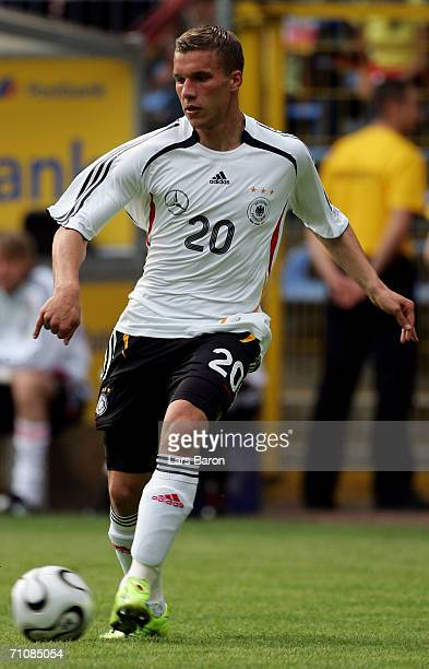 Lukas Podolski of Germany runs with the ball during the practice match between FSV Luckenwalde and the German National Team at the CarlBenz Stadium...