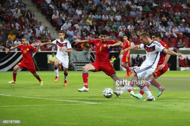 Lukas Podolski of Germany scores his team's second goal during the International Friendly match between Germany and Armenia at Coface Arena on June 6...