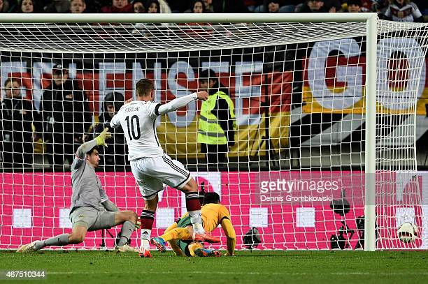 Lukas Podolski of Germany scores his team's second goal during the International Friendly match between Germany and Australia at FritzWalterStadion...