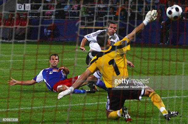 Lukas Podolski of Germany scores the second goal during the FIFA 2010 World Cup Group Four Qualifying match between Liechtenstein and Germany at the...