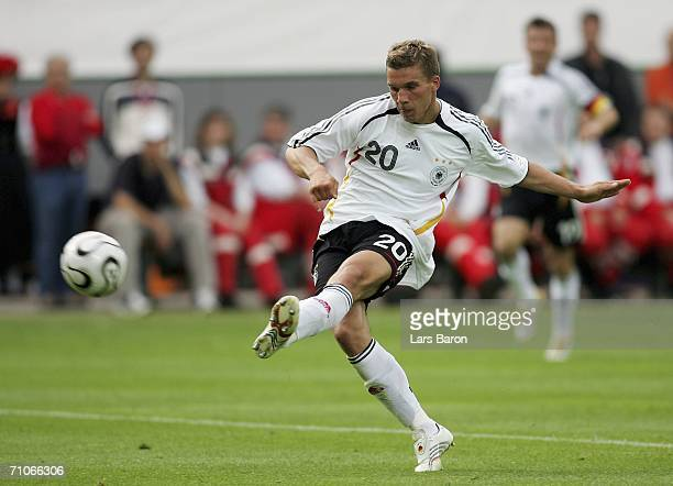 Lukas Podolski of Germany scores the second goal during the friendly match between Germany and Luxembourg at the Badenova Stadium on May 27 2006 in...