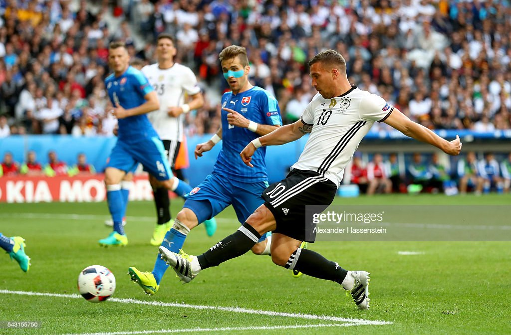 <a gi-track='captionPersonalityLinkClicked' href=/galleries/search?phrase=Lukas+Podolski&family=editorial&specificpeople=204460 ng-click='$event.stopPropagation()'>Lukas Podolski</a> of Germany shoots at goal during the UEFA EURO 2016 round of 16 match between Germany and Slovakia at Stade Pierre-Mauroy on June 26, 2016 in Lille, France.