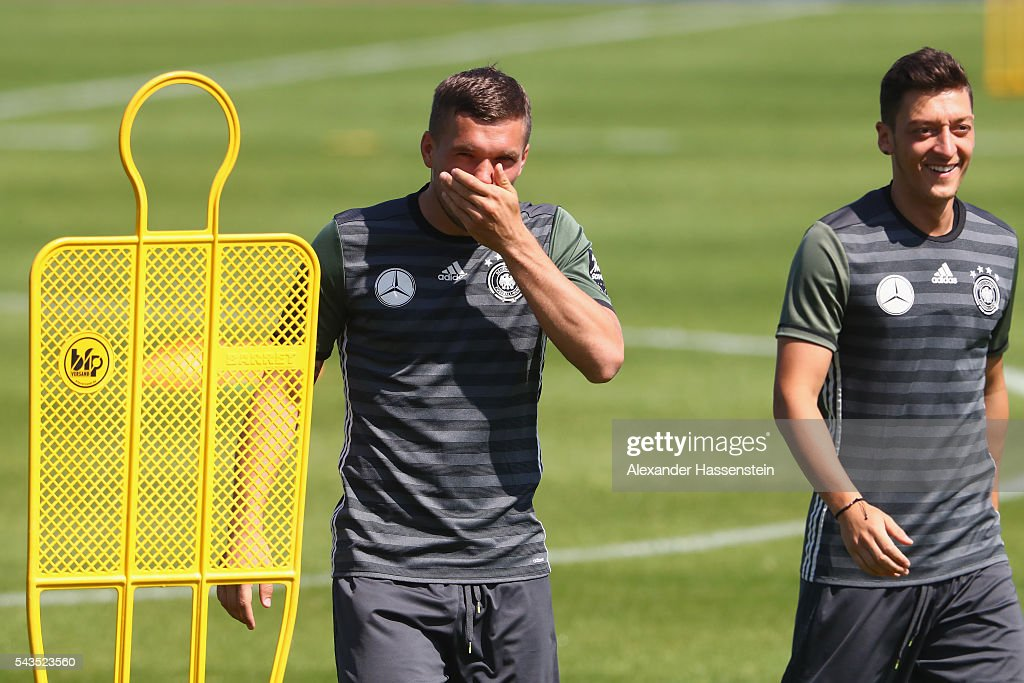 <a gi-track='captionPersonalityLinkClicked' href=/galleries/search?phrase=Lukas+Podolski&family=editorial&specificpeople=204460 ng-click='$event.stopPropagation()'>Lukas Podolski</a> (L) of Germany smiles with his team mate <a gi-track='captionPersonalityLinkClicked' href=/galleries/search?phrase=Mesut+Oezil&family=editorial&specificpeople=764075 ng-click='$event.stopPropagation()'>Mesut Oezil</a> during a Germany training session at Ermitage Evian on June 29, 2016 in Evian-les-Bains, France.