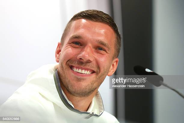 Lukas Podolski of Germany talks to the media during a Germany press conference ahead of the UEFA EURO 2016 at Ermitage Evian on June 14 2016 in...