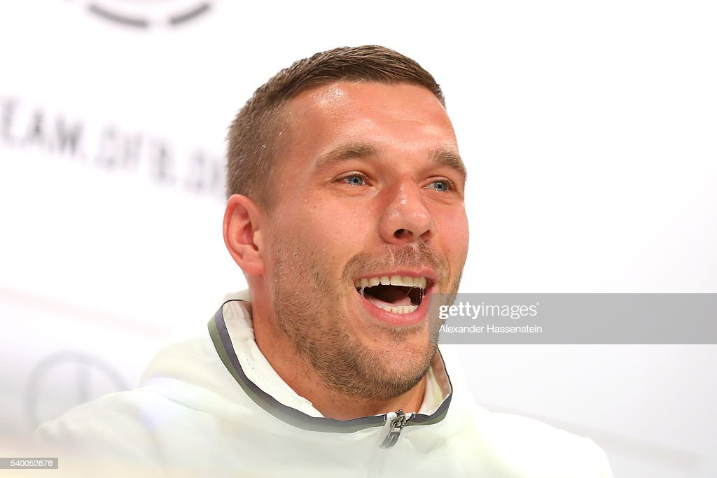Lukas Podolski of Germany talks to the media during a Germany press conference ahead of the UEFA EURO 2016 at Ermitage Evian on June 14, 2016 in Evian-les-Bains, France.