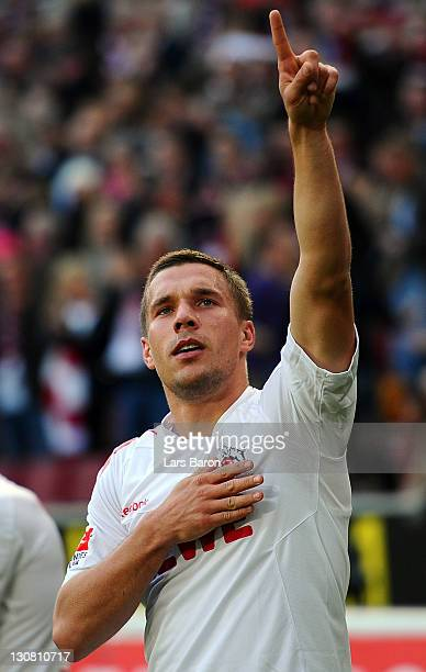 Lukas Podolski of Koeln celebrates after scoring his teams first goal during the Bundesliga match between 1 FC Koeln and FC Augsburg at...