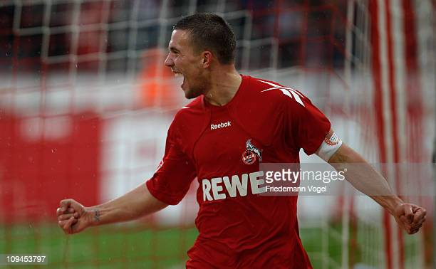 Lukas Podolski of Koeln celebrates scoring the first goal with his team during the Bundesliga match between 1 FC Koeln and SC Freiburg at...