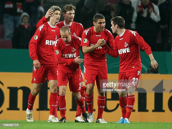Lukas Podolski of Koeln celebrates the second goal with Martin Lanig of Koeln Miso Brecko Youssef Mohamad and Christian Clemens of Koeln during the...