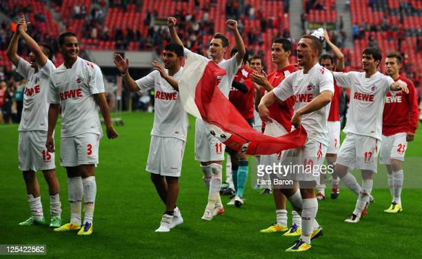 Lukas Podolski of Koeln celebrates with team mates after winning the Bundesliga match between Bayer 04 Leverkusen and 1 FC Koeln at BayArena on...