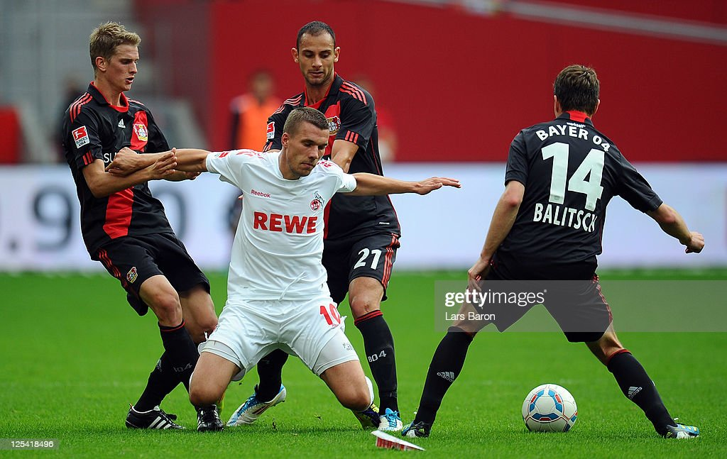 <a gi-track='captionPersonalityLinkClicked' href=/galleries/search?phrase=Lukas+Podolski&family=editorial&specificpeople=204460 ng-click='$event.stopPropagation()'>Lukas Podolski</a> of Koeln is challenged by <a gi-track='captionPersonalityLinkClicked' href=/galleries/search?phrase=Lars+Bender&family=editorial&specificpeople=644948 ng-click='$event.stopPropagation()'>Lars Bender</a>, <a gi-track='captionPersonalityLinkClicked' href=/galleries/search?phrase=Oemer+Toprak&family=editorial&specificpeople=5395932 ng-click='$event.stopPropagation()'>Oemer Toprak</a> and <a gi-track='captionPersonalityLinkClicked' href=/galleries/search?phrase=Hanno+Balitsch&family=editorial&specificpeople=635099 ng-click='$event.stopPropagation()'>Hanno Balitsch</a> of Leverkusen during the Bundesliga match between Bayer 04 Leverkusen and 1. FC Koeln at BayArena on September 17, 2011 in Leverkusen, Germany.