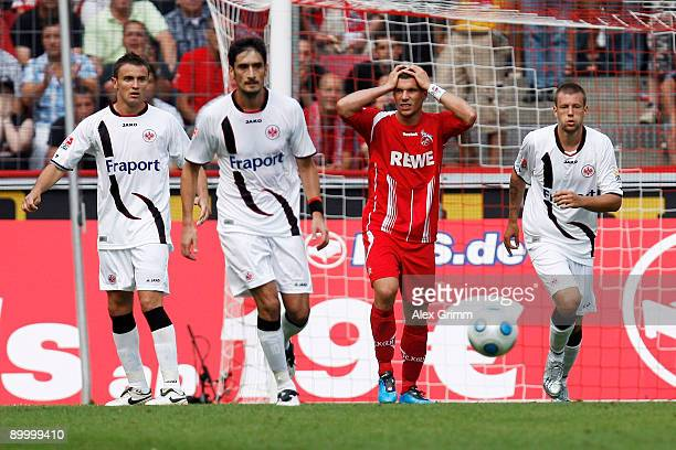 Lukas Podolski of Koeln reacts during the Bundesliga match between 1 FC Koeln and Eintracht Frankfurt at the Rhein Energie Stadium on August 22 2009...