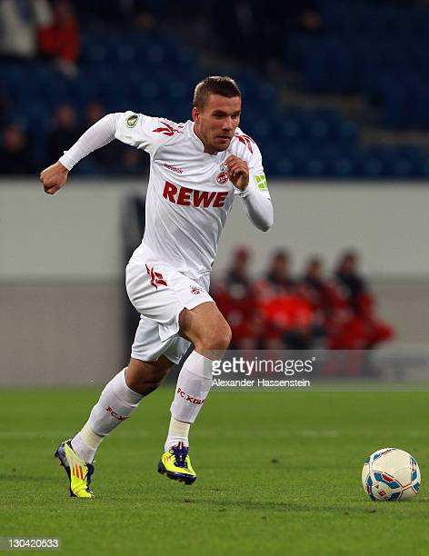 Lukas Podolski of Koeln runs with the ball during the DFB Pokal second round match between TSV 1899 Hoffenheim and 1FC Koeln at RheinNeckarArena on...