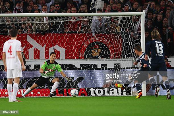 Lukas Podolski of Koeln scores his team's first goal with a penalty against goalkeeper Sven Ulreich of Stuttgart during the Bundesliga match between...