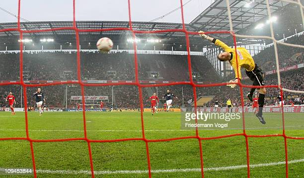 Lukas Podolski of Koeln scoring the first goal during the Bundesliga match between 1 FC Koeln and SC Freiburg at RheinEnergieStadion on February 26...