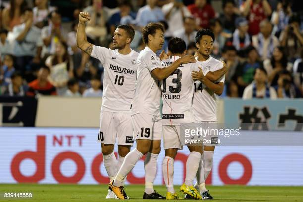 Lukas Podolski of Vissel Kobe celebrates scoring the opening goal with his team mates during the JLeague J1 match between Jubilo Iwata and Vissel...
