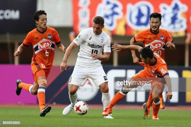 Lukas Podolski of Vissel Kobe controls the ball under pressure of Albirex Niigata defense during the JLeague J1 match between Albirex Niigata and...