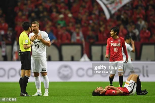Lukas Podolski of Vissel Kobe protests to referee Takuto Okabe during the JLeague J1 match between Urawa Red Diamonds and Vissel Kobe at Saitama...