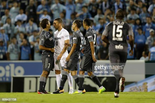 Lukas Podolski of Vissel Kobe squares off with Jubilo Iwata players during the JLeague J1 match between Jubilo Iwata and Vissel Kobe at Yamaha...