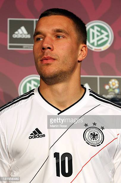 Lukas Podolski poses with his Jersey during the Germany national team Euro 2012 jersey launch at Mercedes Benz Center on November 9 2011 in Hamburg...