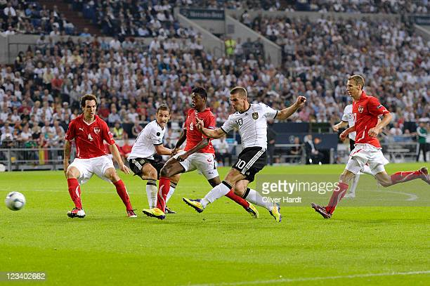 Lukas Podolski scores the third goal of Germany during the UEFA EURO 2012 qualifying match between Germany and Austria at VeltinsArena on September 2...