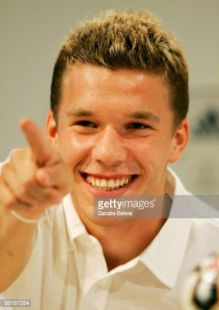 Lukas Podolski smiles and points to a journalist during the German National Team press conference for the Confederations Cup 2005 at the Adidas World...