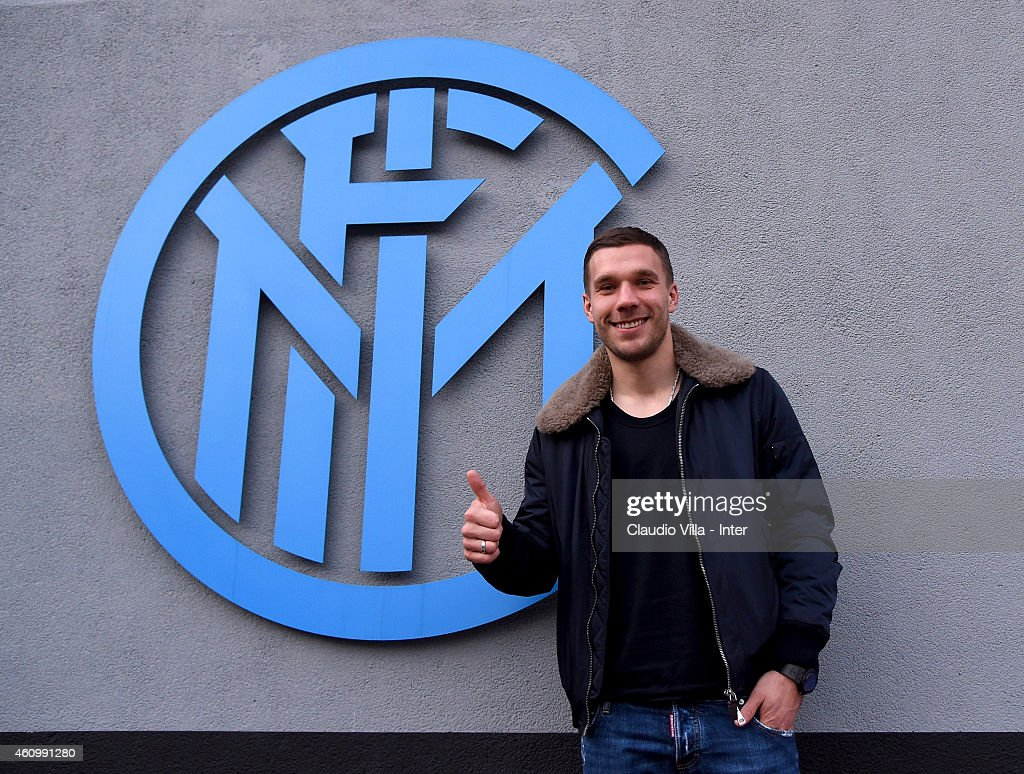 Lukas Podolski, who is set to join FC Internazionale on loan until the end of the season, poses for a photo in front of the club's logo at Appiano Gentile on January 03, 2015 in Como, Italy.
